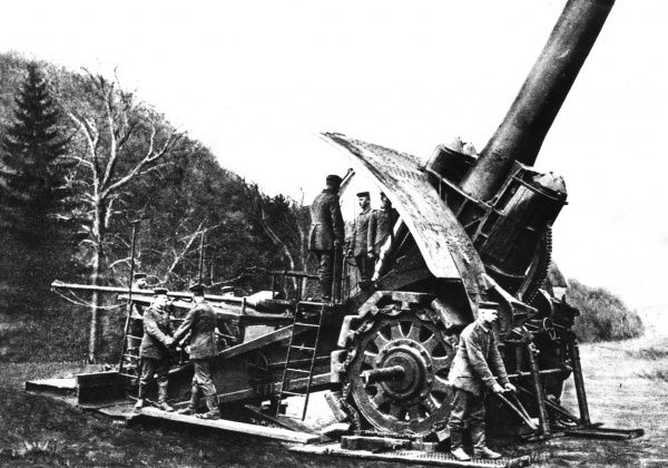 A German 42cm Big Bertha howitzer in action on the Western Front during the First World War. It was manufactured by Krupp. Seen here with gunners, preparing to fire. Date: 1914-1918