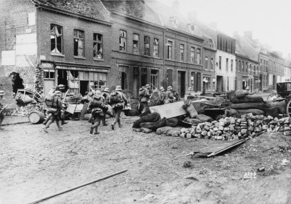 German soldiers advancing into Bailleuil in France during the Spring Offensive on the Western Front during World War I
