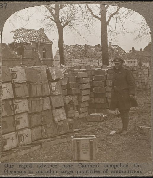 Ammunition supplies left behind by the Germans after the British advance near Cambrai; bombed and roofless houses provide the backdrop