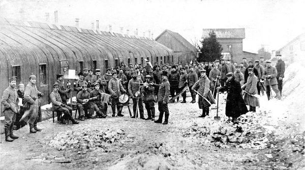 A German band, with top-hatted conductor, in an enemy camp at the front