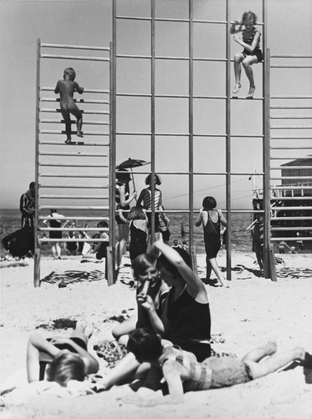 Climbing frames on the beach and a family on holiday in Warnemunde, Germany in 1936