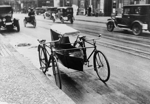 A bicycle boat on a street in Germany. Date: early 1930s