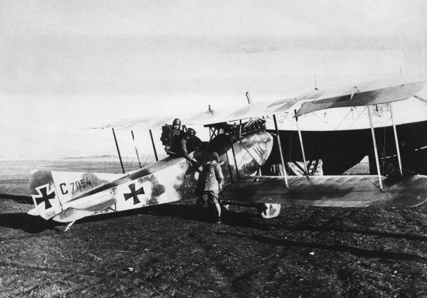 A German reconnaissance AEG C.IV biplane with two crew on the Palestine Front in Turkey during the First World War. The large camera used is clearly visible. Date: 1914-1918