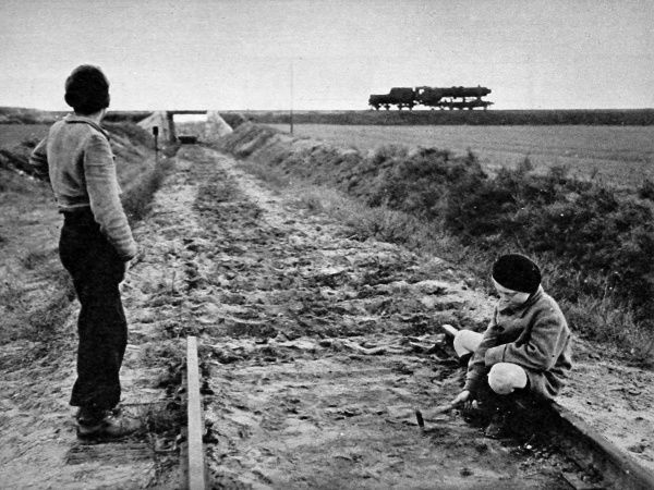 Photograph showing two German boys playing on a railway track leading into the American Sector of West Berlin, November 1948