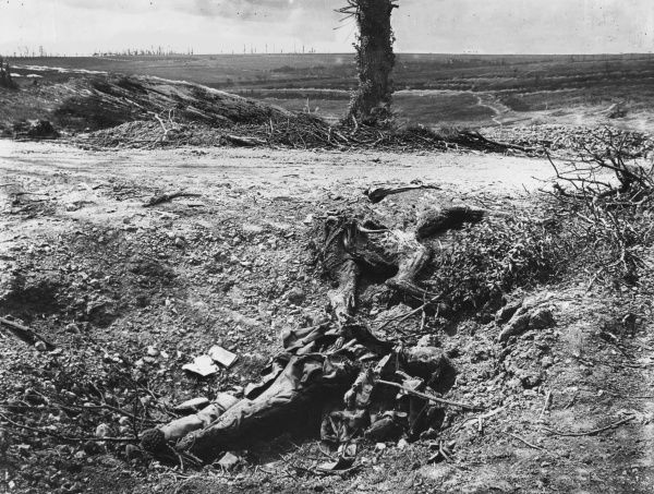 The remains of a German casualty of the fighting lies to the side of a rough track somewhere on the Somme