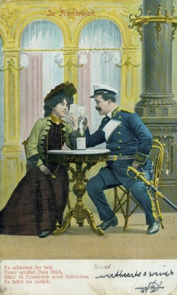 A German couple raising their glasses in a toast, and looking into each other's eyes. The man is wearing a blue and white uniform, together with a ceremonial sword. Date: early 20th century