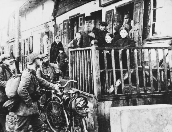 A detachment of German Army cyclists talk to Polish villagers on the Eastern Front