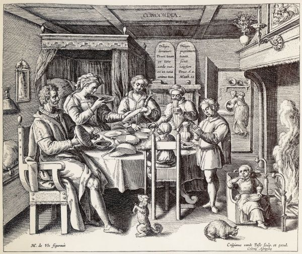 The family of a German burgher share a meal together round a table