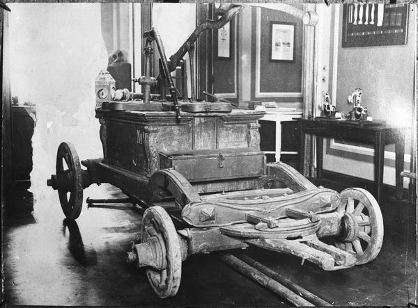 A fire engine with a brass pump, dating from the reign of Friedrich II. It was presented to Prince Henry of Prussia. Photographed when it was in the Fireman's Museum, Berlin. Date: 18th century