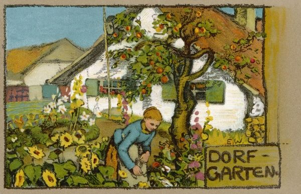 A lady tends her cottage garden in a German village