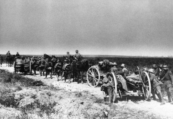 German gunners transporting 77mm field guns along a road on the Western Front during the First World War. Date: 1914-1918