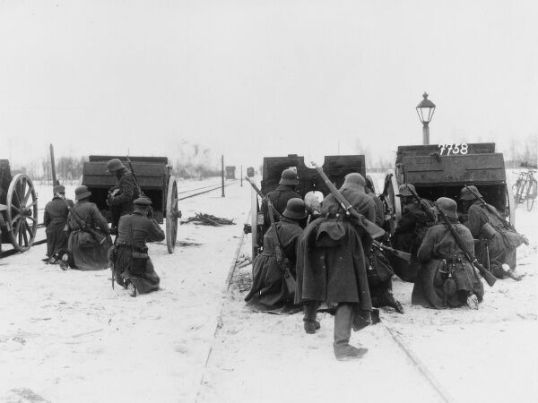 German troops fire on Bolshevik held positions while finding cover behind carts, somewhere on the Eastern Front