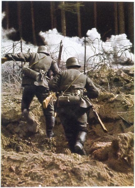 German infantry in action - checked by barbed wire