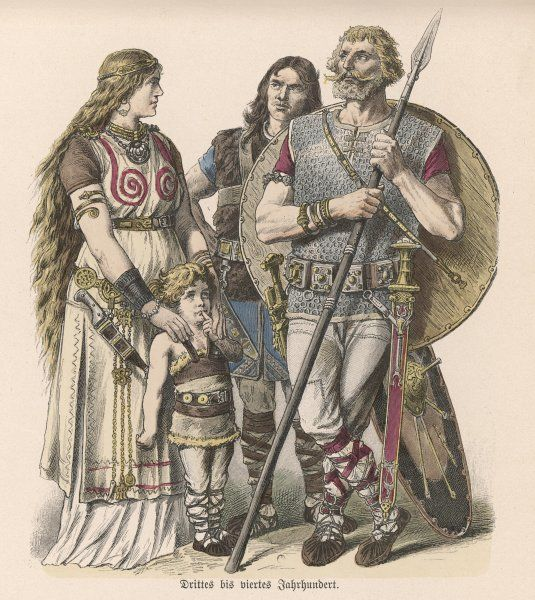 Two tribal warriors stand with a woman who, like them is armed as she holds her child ; she wears an armlet and much other ornament