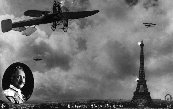 A propaganda postcard showing German planes flying over Paris during the First World War, with the Eiffel Tower, and an inset portrait of Kaiser Wilhelm II. Date: 1914-1918
