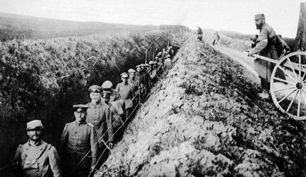German prisoners being led through a French trench so they are less exposed to their own shell-fire