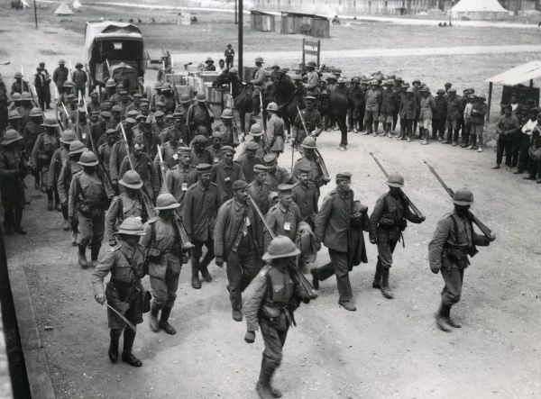 German prisoners under British escort, being marched to a railhead on the Balkan Front, at the time of the Battle of Machukovo during the First World War. Date: September 1916