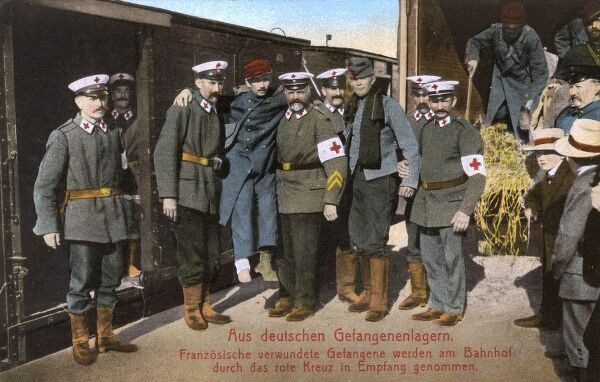Wounded French POWs from German prison camps received at a railwaty station by the German Red Cross. Date: circa 1916