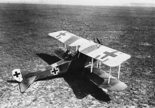 A German Rumpler-Taube two-seater plane during the First World War. A crew member can be seen in the gunner's seat, holding a rifle. Date: 1917-1918