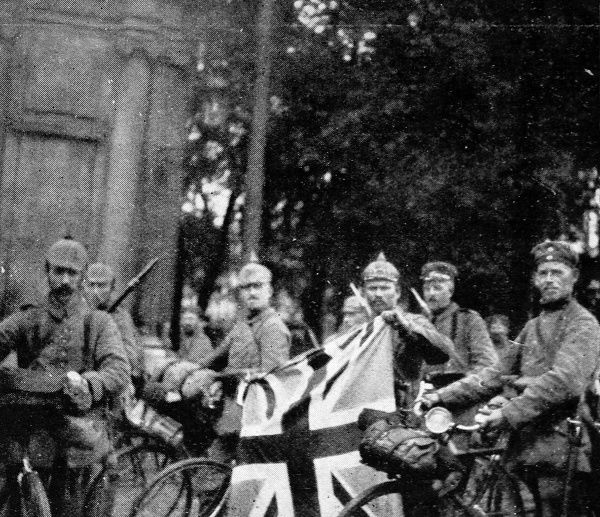 German soldiers flaunting the Union Jack flag in Bruges during their westward advance into Belgium in October 1914