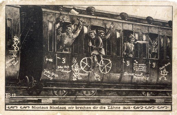 'Nicolaus, Nicolaus, we're coming to break your teeth !' - happy German soldiers on their way to the Russian front on a train labelled 'Direct to Petersburg&#39