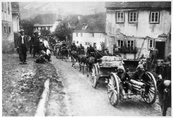 The German invasion of France - passing through a village some 50 kilometres from Paris, watched by villagers who have no reason to expect anything but the worst