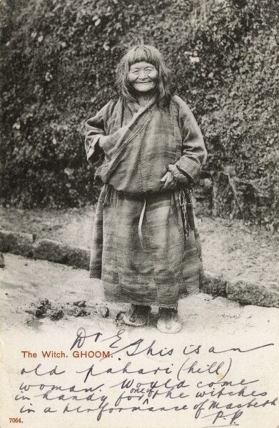 Ghoom (Ghum, Darjeeling, Northern India), A Tibetan Witch. The humorous hand-written message on the front, makes note that this elderly (and rather kindly-looking) woman would be the ideal candidate for a role in Macbeth! Date: 1904