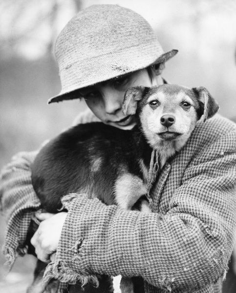 A charming portrait of a gypsy boy and his little dog