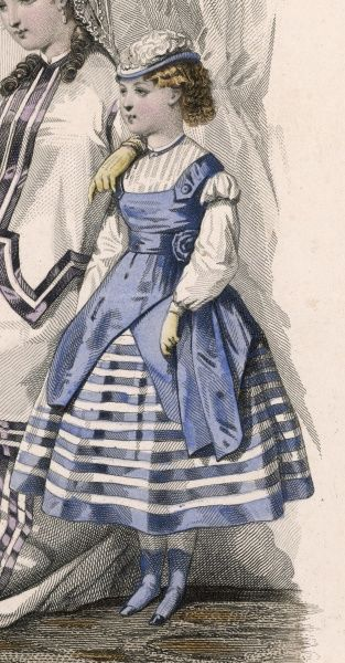 Little girl in a fashionable blue and white dress