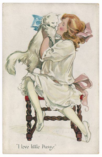 A girl in white clutches a white cat : the girl has a pink ribbon in her hair and another at her waist, the cat has a blue one round its neck