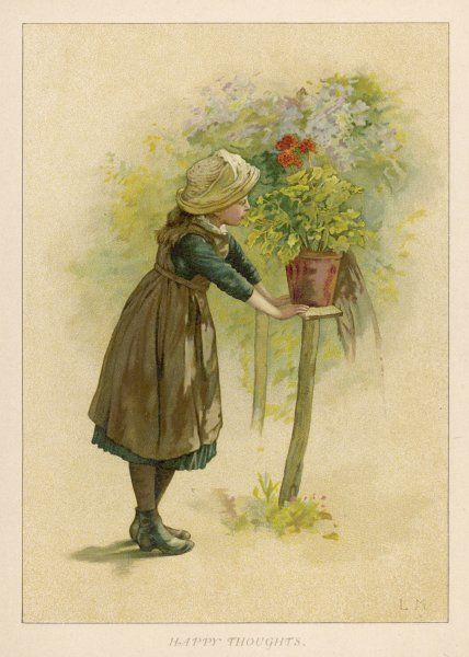 A little girl in a garden admires a potted plant