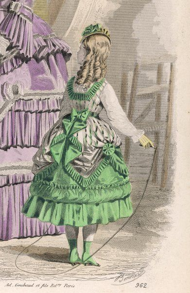 Girl with ringlets: green & white striped tunic dress, square cut corsage, ribbon ceinture & pointed hem drawn up over a short green skirt with flounce & bouillon trim