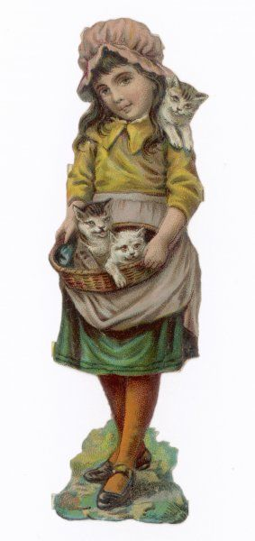 A little girl with a kitten balancing on her shoulder and two more in a basket