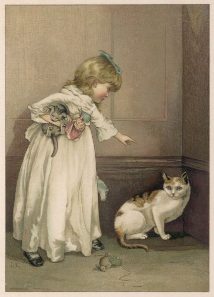 A little girl holds a kitten under her arm and reprimands a naughty cat, who looks unrepentant
