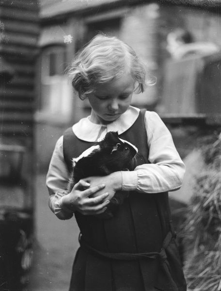A girl holding her Guinea Pig