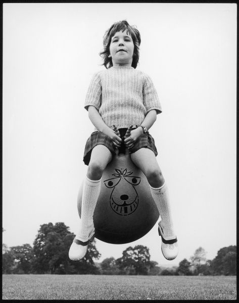 A girl bounces high into the air on her spacehopper, one of the classic new toys of the 1970s. (Picture 2 of 4)