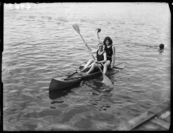 Two girls larking about in a canoe!