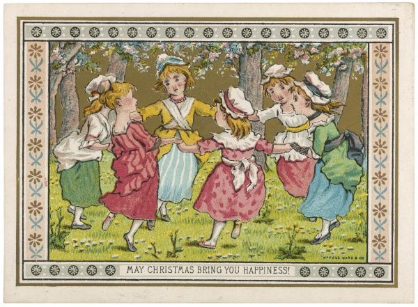 A group of girls dance beneath blossoming trees