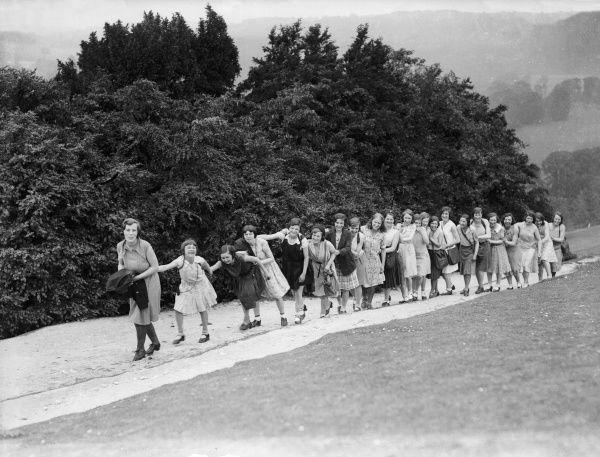A row of rather boisterous looking schoolgirls, about to set off on a school hiking trip