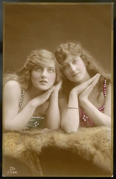 Two beautiful young ladies (sisters?) pose for a portrait