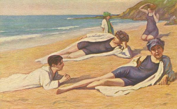 Girls sunbathing on the sand. Date: 1920s