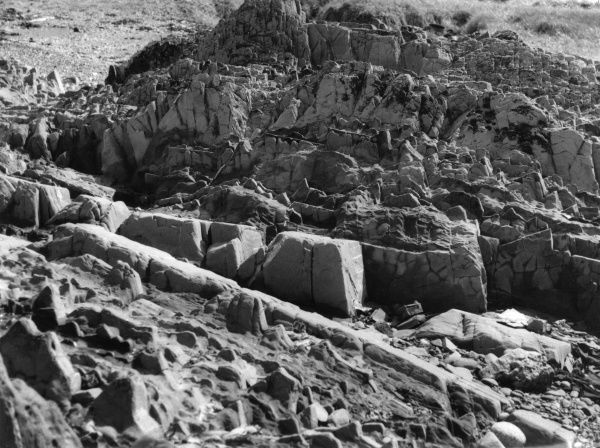 A rock formation on the beach near Girvan, Ayrshire, Scotland, showing the erosion caused by many tides. Date: BC