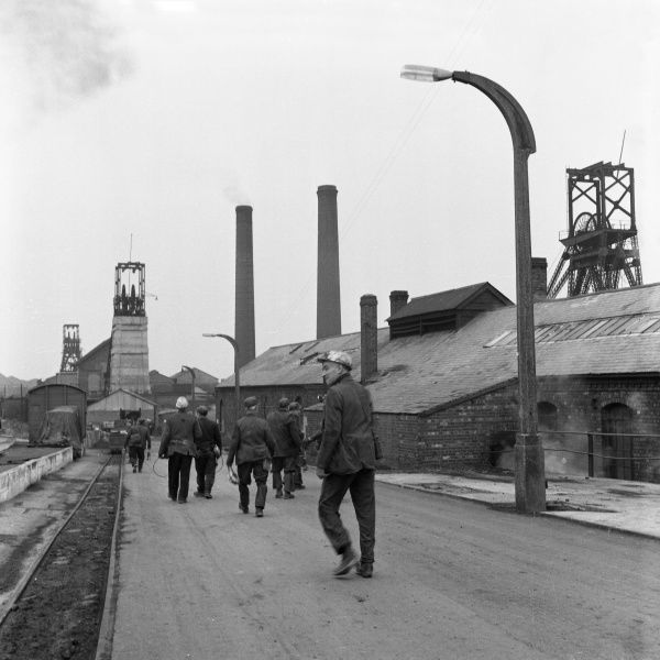 A group of miners from Glapwell Colliery, north east Derbyshire, start their shift. Glapwell colliery closed in the 1970s
