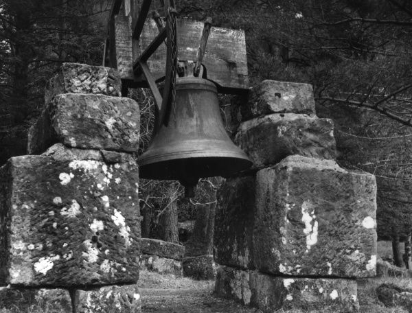 Church bell in the grounds of Glenfinnan Church, Inverness- shire, Scotland. It was originally intended for the church tower, but it proved to be too heavy! Date: 1930s