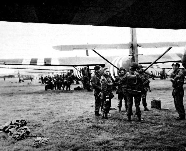 Photograph showing gliders and men of the Allied Airborne Army, on an airfield somewhere in Britain, September 1944