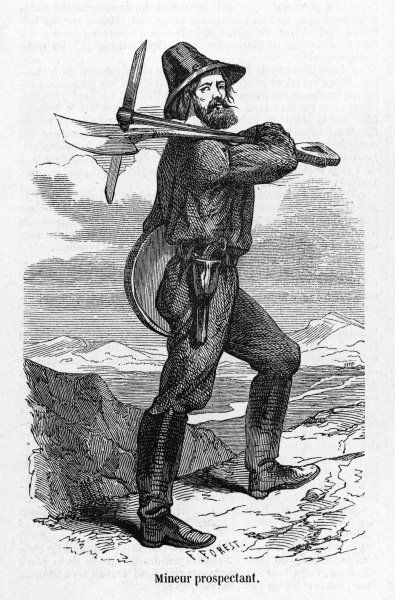 A prospector, armed with pick and shovel, sieve and six- shooter
