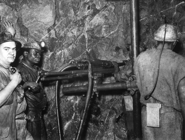 Miners drilling the rock face of a Wit Watersrand gold mine, South Africa. Date: 1930s