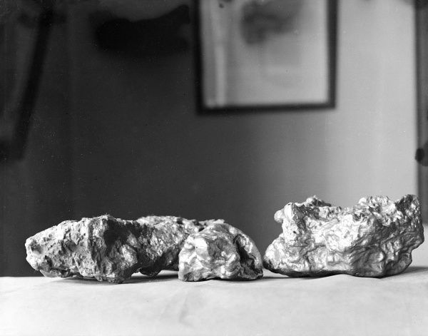 Two large nuggets of gold. Date: 1930s