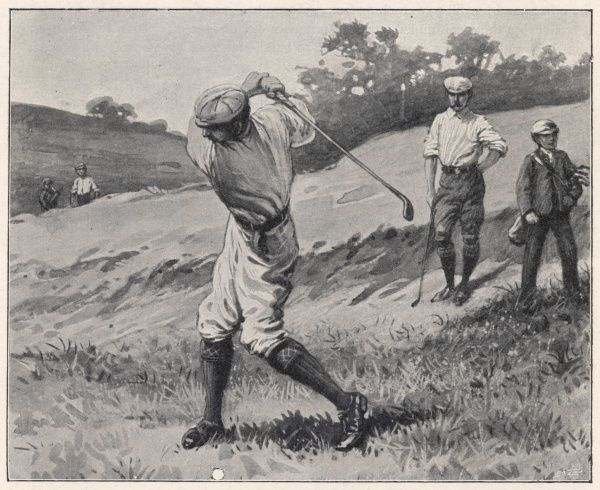Playing a shot from the fairway, a golfer reaches the top of his backswing, watched by his partner and a caddy