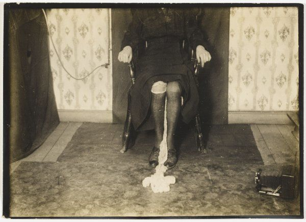 Kathleen exudes ectoplasm from between her legs ; sometimes it would become sufficiently rigid to tilt a small table